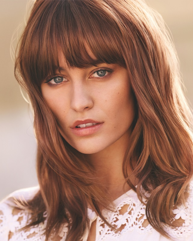Soft fringe framing the face….