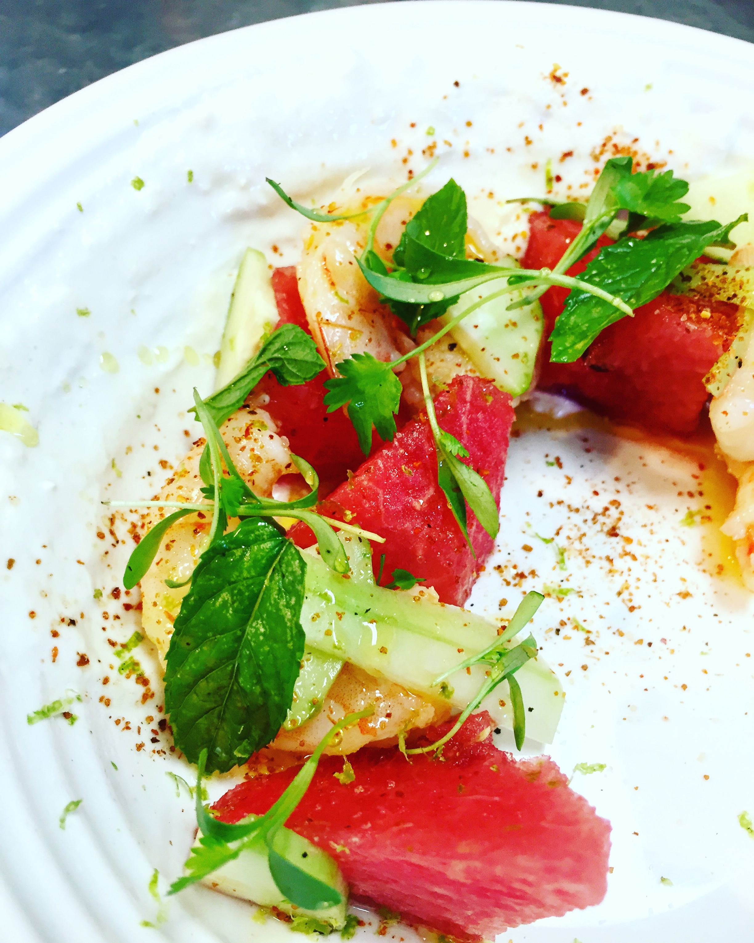 watermelon, Louisiana pickled shrimp, cucumber, sweet corn, labneh, tajin, and keffir lime