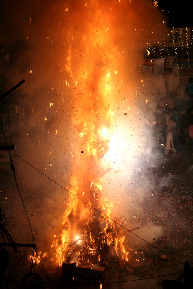 Holi Bonfire in front of Jagdish Temple / Udaipur; photo by Ingo Mehling via Wikimedia Commons.