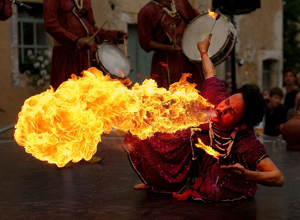"Fire breathing ""Jaipur Maharaja Brass Band"", Chassepierre, Belgium; photo by Luc Viatour via Wikimedia Commons."