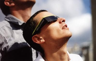 A viewer of the Solar Eclipse on Aug 11, 1999 in Paris, France; photo by Arnaudh via Wikimedia Commons.