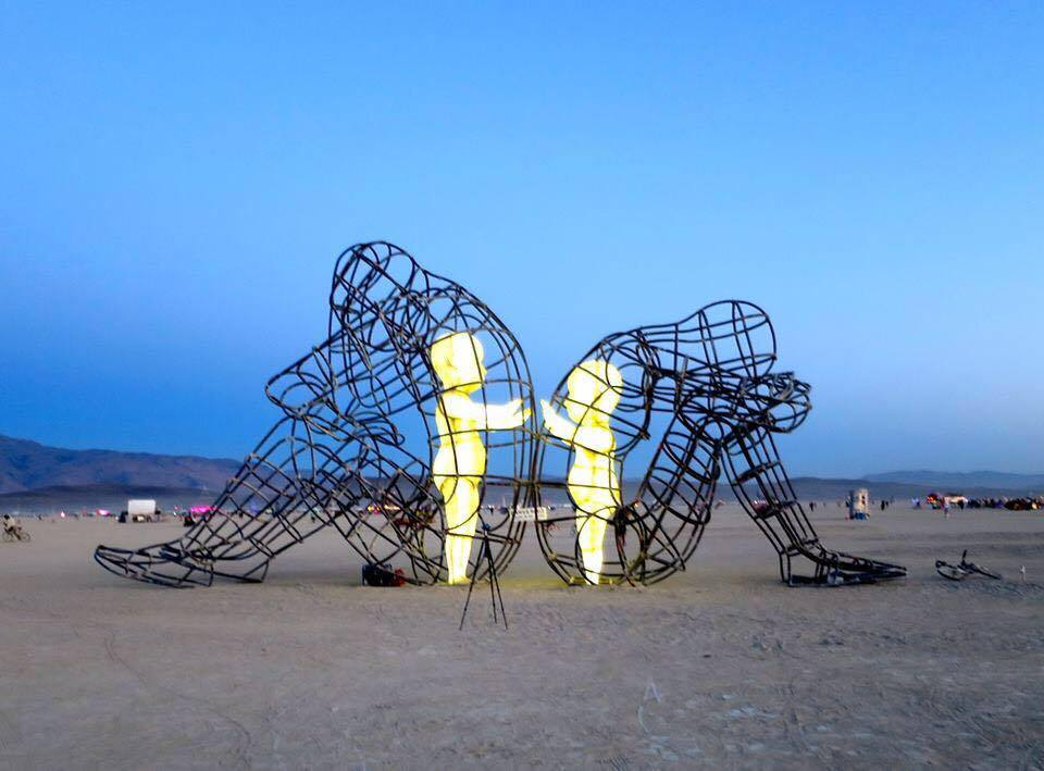 Burning Man Sculpture of Inner Child Parts Reaching by Alenandr Milov, 2015