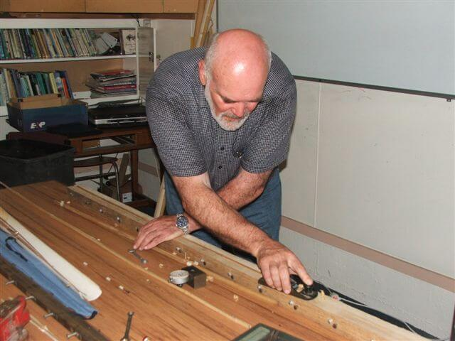 With the use of the micro guage and  the adjusting screws on the clamp Ian is able to set the taper for the individual rod sections.JPG