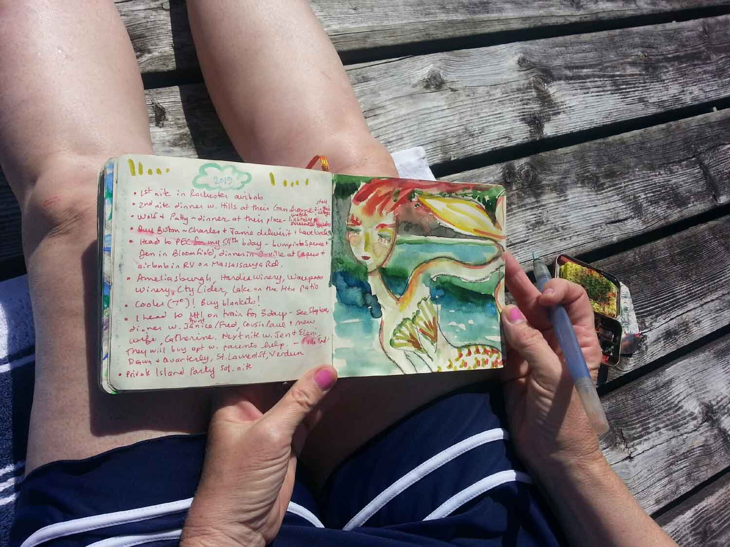 Painting mermaids at the cottage.