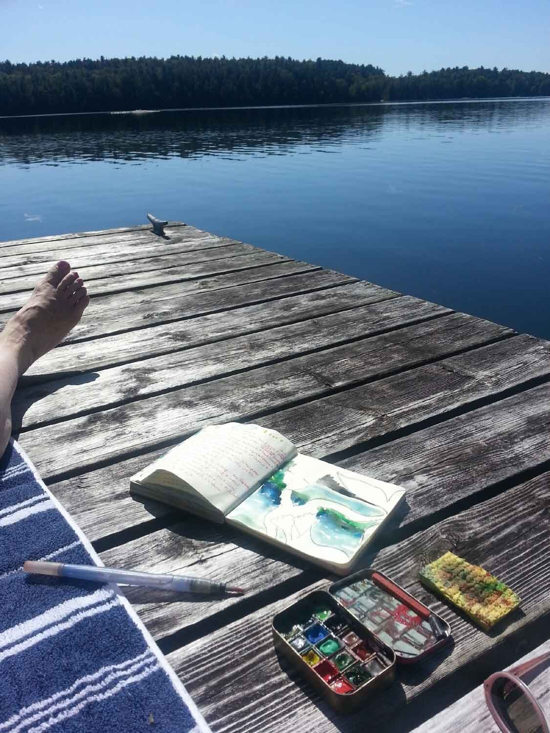 Painting with watercolors on the dock