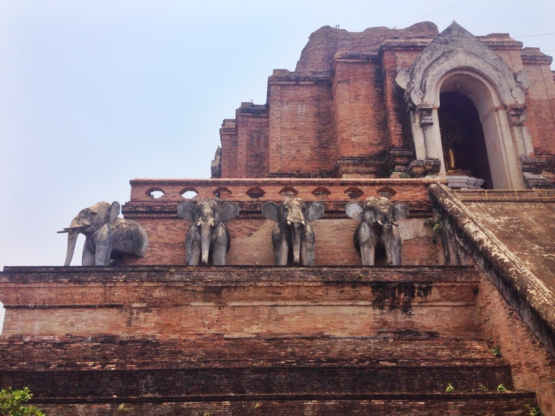 The exterior of an old brick temple in Chiang Mai