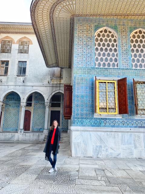 standing outside the harem