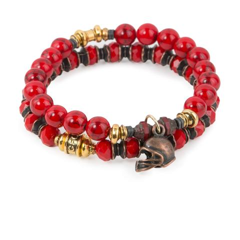 """Red Zone (Set of Two)  Red crystal glass and synthetic turquoise bracelet set of two with Czech glass accents, mixed metal detail, and copper-tone helmet charm. Measures approximately 7.5"""" in length. With the purchase of this bracelet set, 25% of gross profit goes to V-Day.  All bracelet sets come with a hang-tag detailing the mission of each charity."""