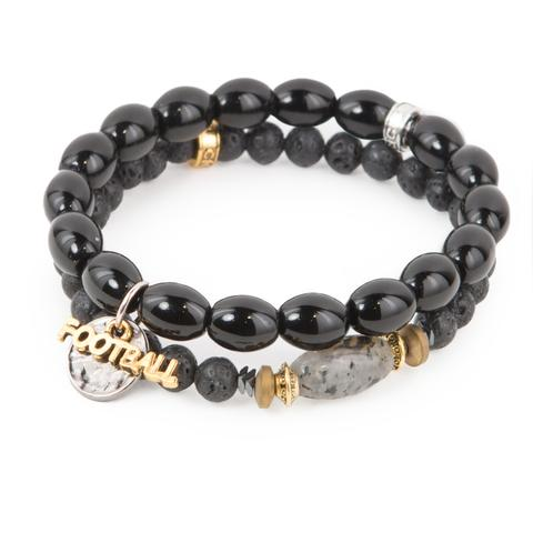 """Game Day  (Set of Two)   Black lava rock and glass bracelet set of two with mixed metal detail and football charms.Measures approximately 7.5"""" in length. With the purchase of this bracelet set, 25% of gross profit goes to Gift for Life.  All bracelet sets come with a pouch and a hang-tag detailing the mission of each charity."""
