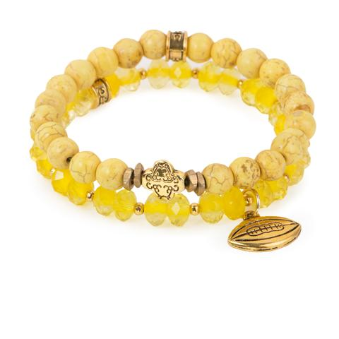 """First and Goal (Set of Two)  Yellow magnesite and crystal glass bracelet set of two with gold ornate accent and football charm. Measures approximately 7.5"""" in length.With the purchase of this bracelet set, 25% of gross profit goes to Alex's Lemonade Stand Foundation.  All bracelet sets come with a pouch and a hang-tag detailing the mission of each charity."""