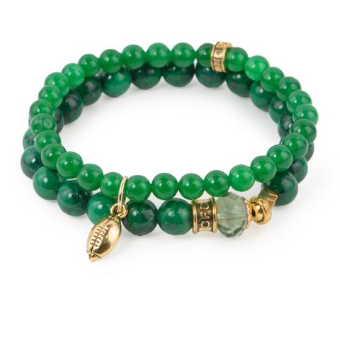 "Go, Fight, Win  (Set of Two)  Green-dyed jade and synthetic turquoise bracelet set of two with Czech glass accent and gold mini football charm. Measures approximately 7.5"" in length. With the purchase of this bracelet set, 25% of gross profit goes to the Whole Planet Foundation.   All bracelet sets come with a pouch and a hang-tag detailing the mission of each charity."