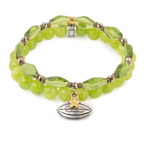 "Football Star  (Set of Two)  Green Czech glass and dyed jade bracelet set of two with hematite detail and mixed metal football charms. Measures approximately 7.5"" in length. With the purchase of this bracelet set, 25% of gross profit goes to the Whole Planet Foundation.  All bracelet sets come with a pouch and a hang-tag detailing the mission of each charity."