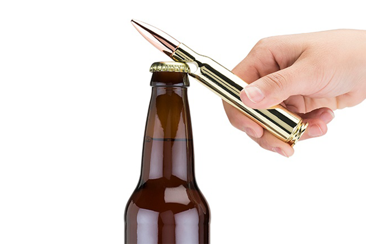 Bullet Bottle Opener   Choose a bottle opener that's of a higher caliber than most. A burnished copper projectile with an equally polished gold casing simulates the size and impressive shape of a 50 caliber bullet, built tough to break open any brew of his choosing.