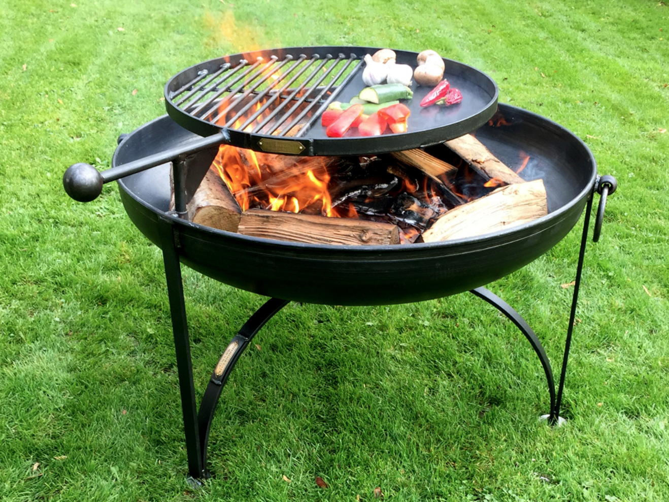 Wood-Burning Fire Pits   Practical yet functional with three sizes available, and the swing arm is fully removable by simply lifting off post cooking allowing him to enjoy the warmth, light and atmosphere of this fire pit late into the evening.