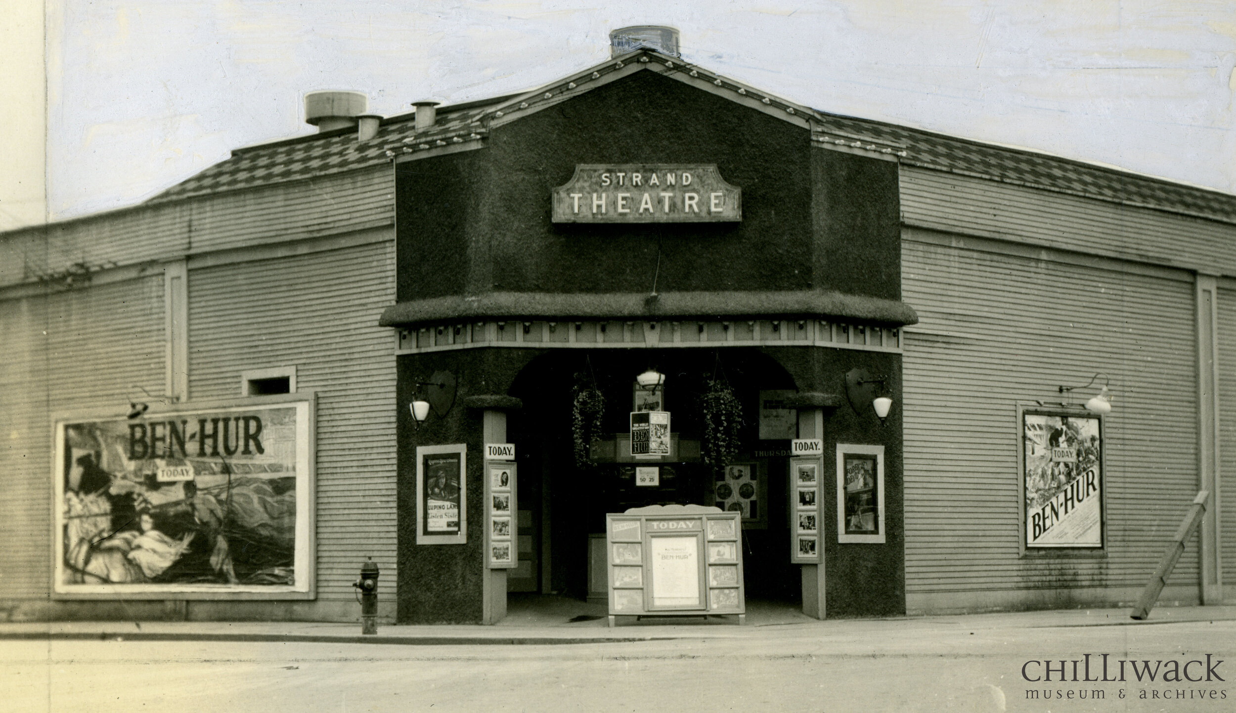 Front view of the Strand Theatre at the corner of Wellington Avenue and Main Street