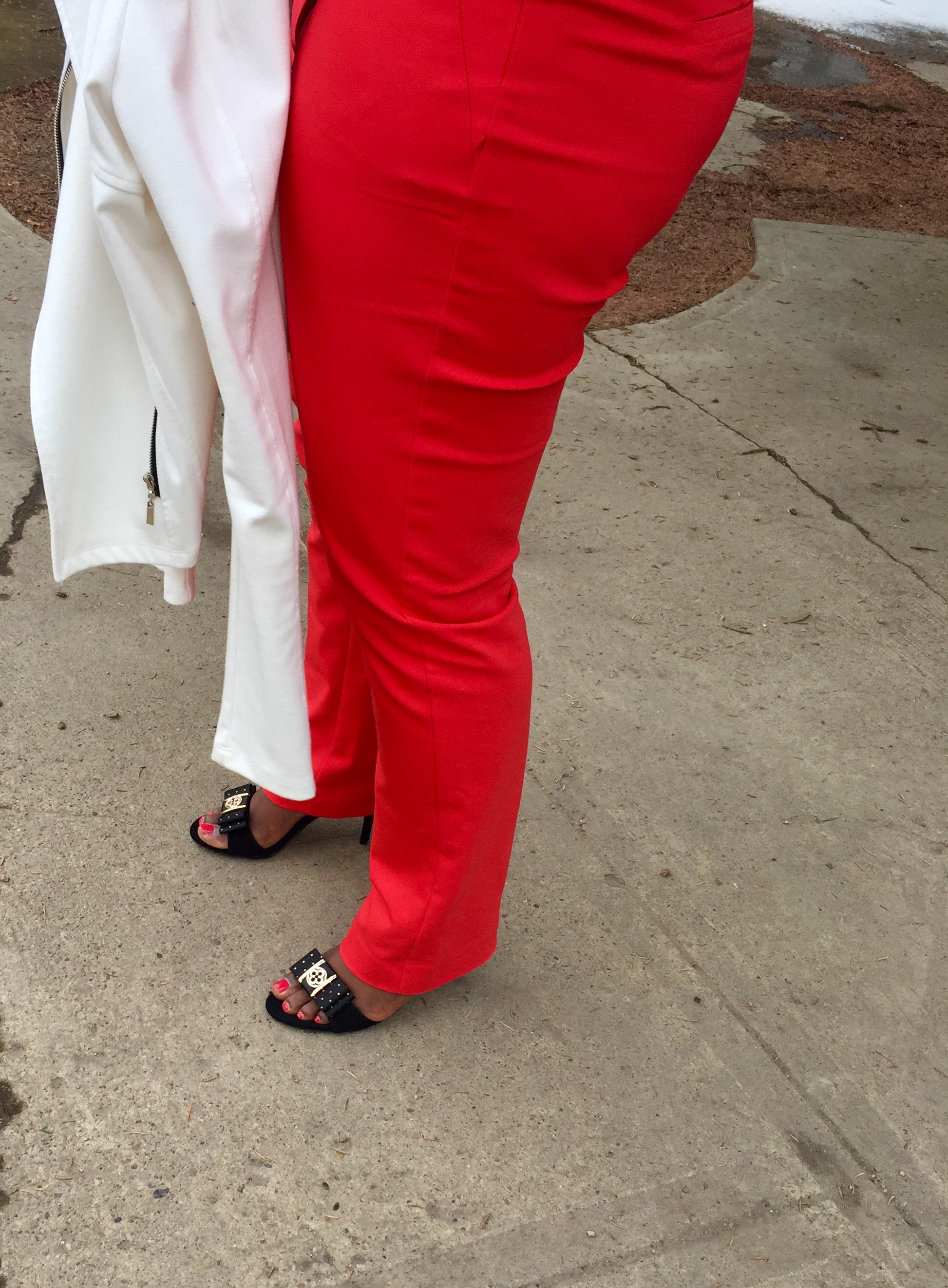 Red pants black sandals with shoellery