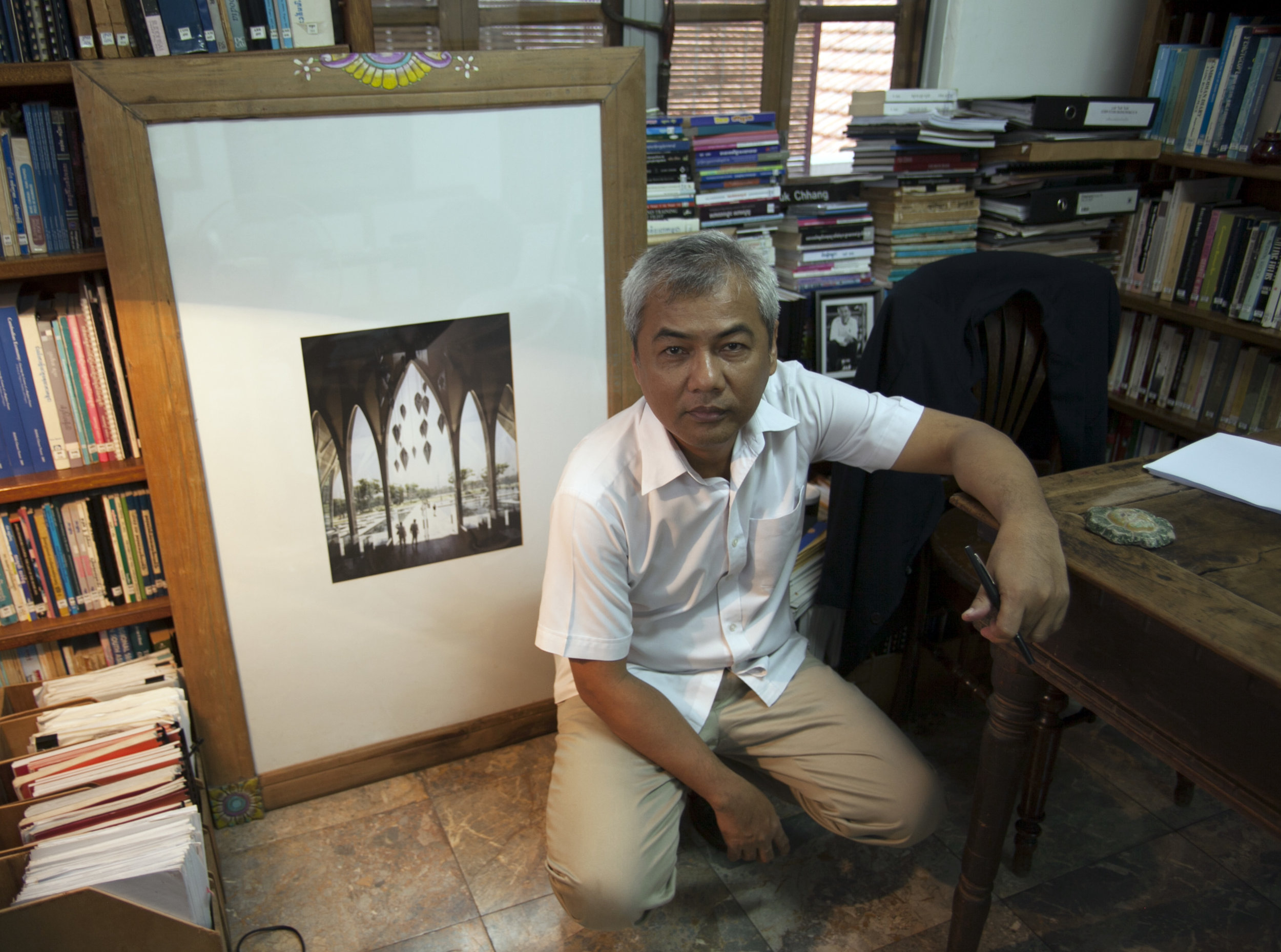 Youk Chhang, Director of the Document Centre Cambodia, with architectural design by Zaha Hadid for the Sleuk Rith Institute. Image courtesy of Brook Andrew.