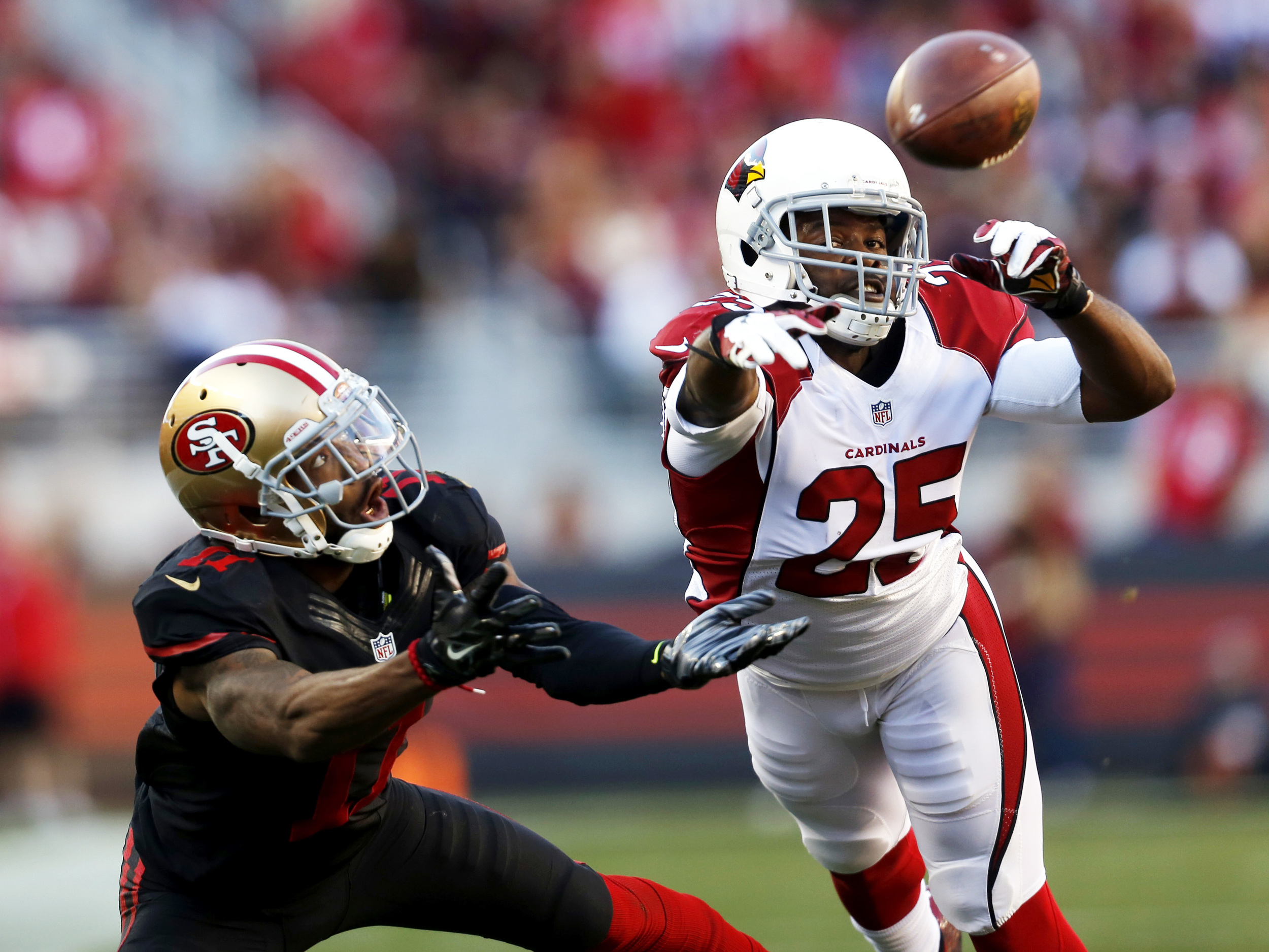 Quinton Patton (11) and Jerraud Powers (25) dive for a pass during a game between the 49ers and the Arizona Cardinals at Levi's Stadium on Sunday, Nov. 29, 2015.