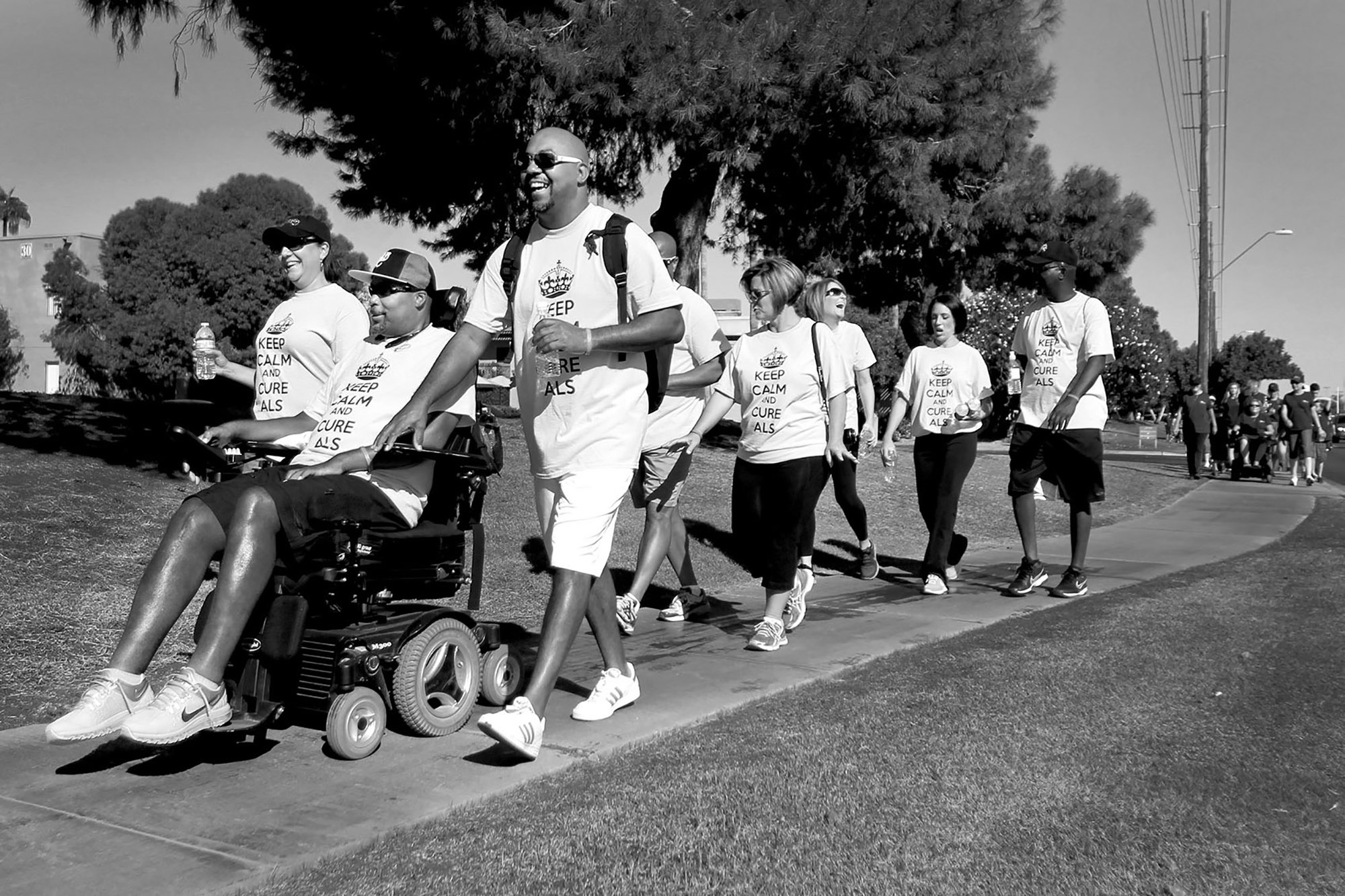 Mike drives alongside his former housemate Decarus Bennett, Rene and other supporters during the annual Walk to Defeat ALS in Scottsdale, Arizona.