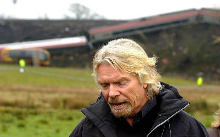 Richard Branson faces the media in the wake of the Cumbria train crash
