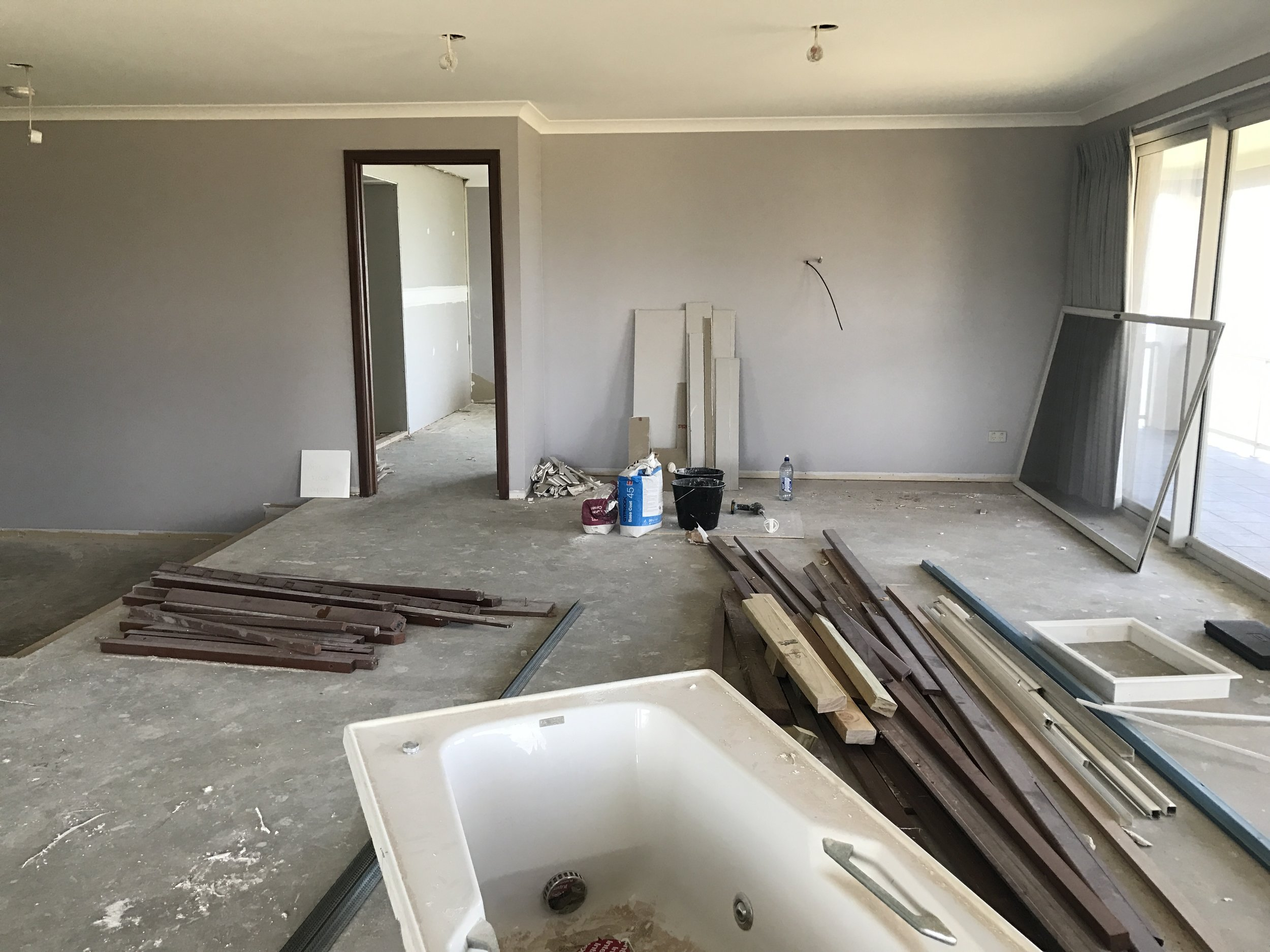 BEFORE: This space was a tired, outdated room and then a cluttered building space when we started this Minted Interiors project. Both of which created a flat uneasy vibe.