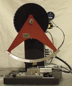 Figure 1 - Table Top Plastic Test Machine for Izod, Charpy, and Dynamic Tensile Testing (photo shows pneumatic Izod clamp with user controlled clamping force).