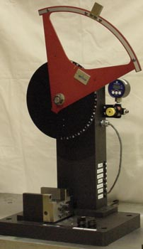Figure 2 - This Photo Shows the Charpy Testing Configuration. The Pendulum has the Essential Weight Plates that Bring the Pseudo-Mass to 1.0 lb for a  Nominal 2 ft-lb Baseline Energy Capacity.