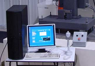 The scanner and push button consolette provide a  streamline high specimen volume throughput.