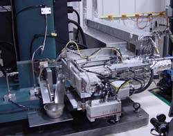 MPM's Automatic Charpy Specimen Transfer System on a Floor Model Impact Machine