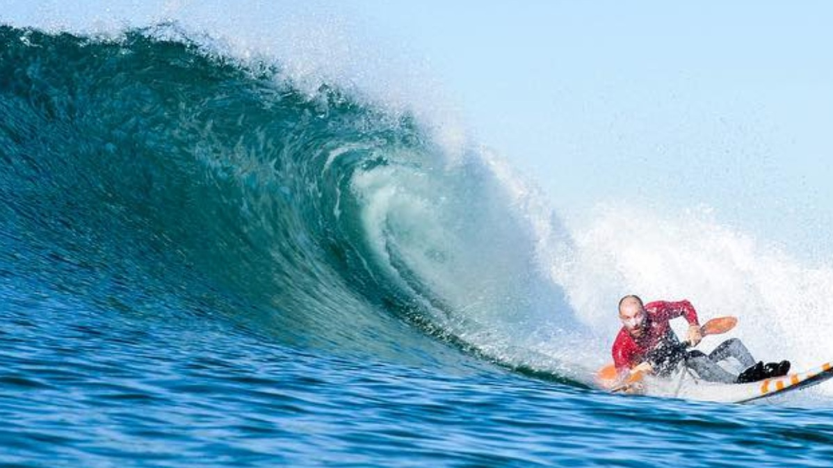 Jeremy P. McGhee  catching waves at Cardiff Reef with photographer  John Afshari.