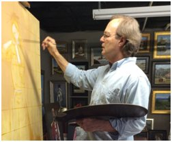 Robert Crum painting in his studio at Clearwater Artist Studios