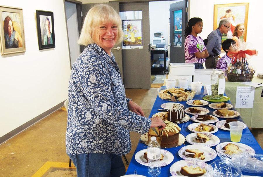 Patty Smith, Volunteer Extraordinaire, serves cake (3rd Annual Portrait Paint-Off, 2017)