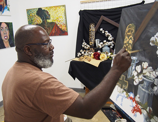 Kevin Harris Painting in his ClearWater Studio