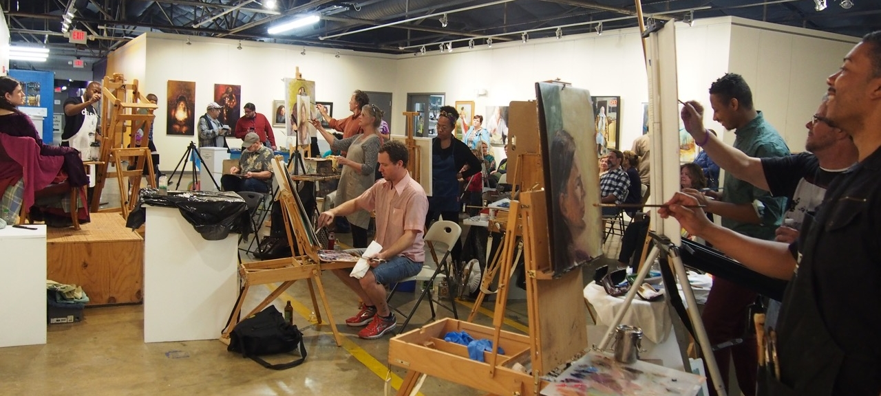 Painters at work with audience watching at the 2017 Paint-Off!