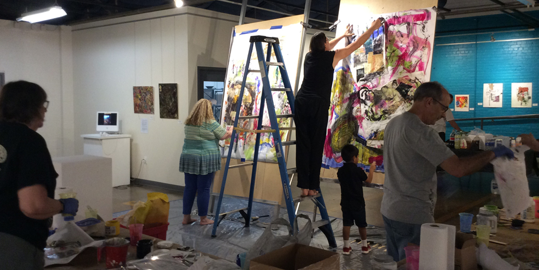 Artists working on the Opening Live Collaborative Painting Day Event-- we'll use these same Giant Easels for Family Painting Day!