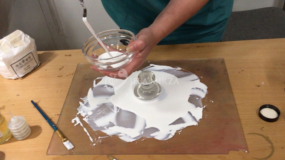 transferring the paint to a bowl