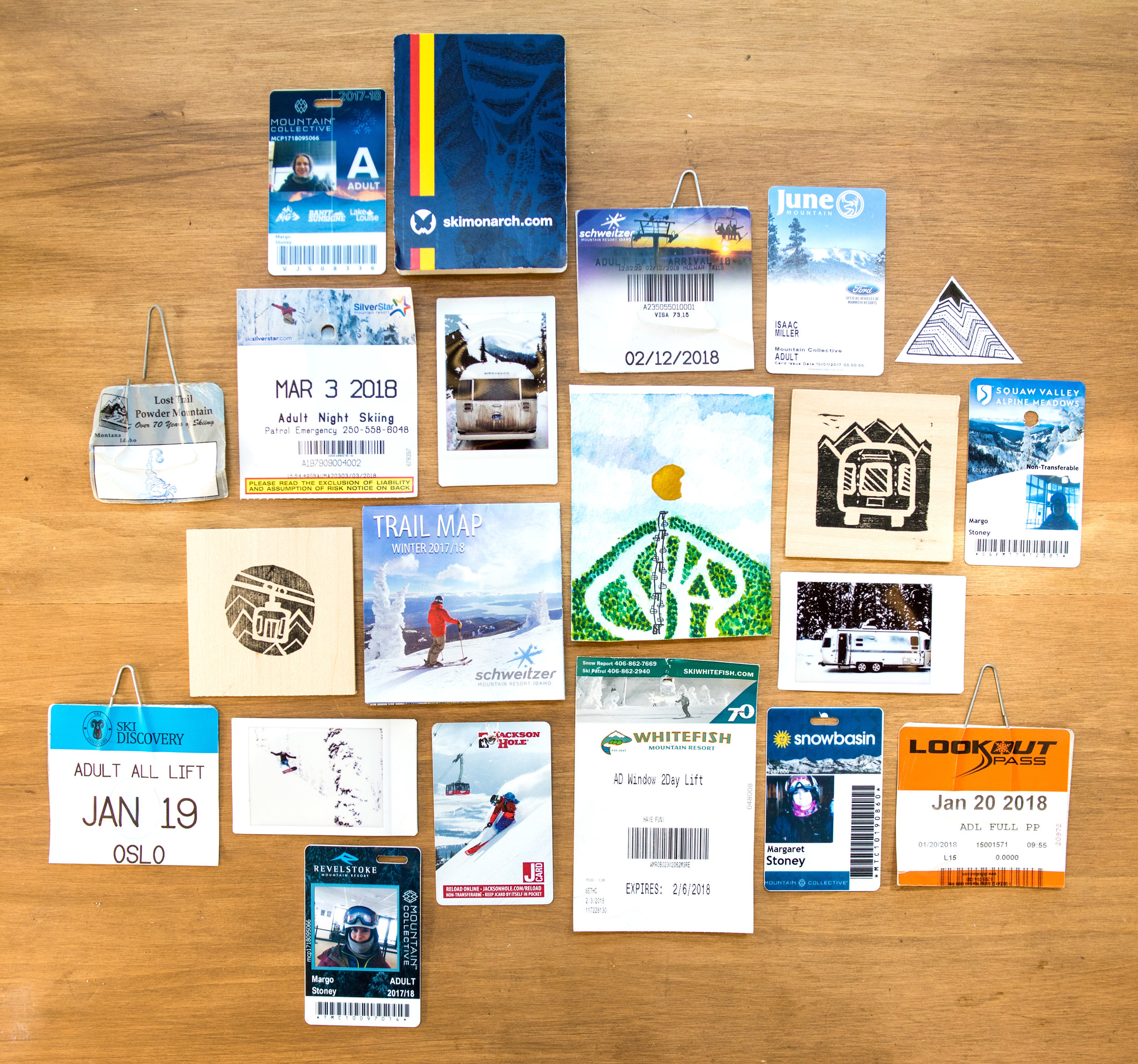 A scrapbook collection of lift tickets, ski passes, trail maps, photos and artwork from along the way.