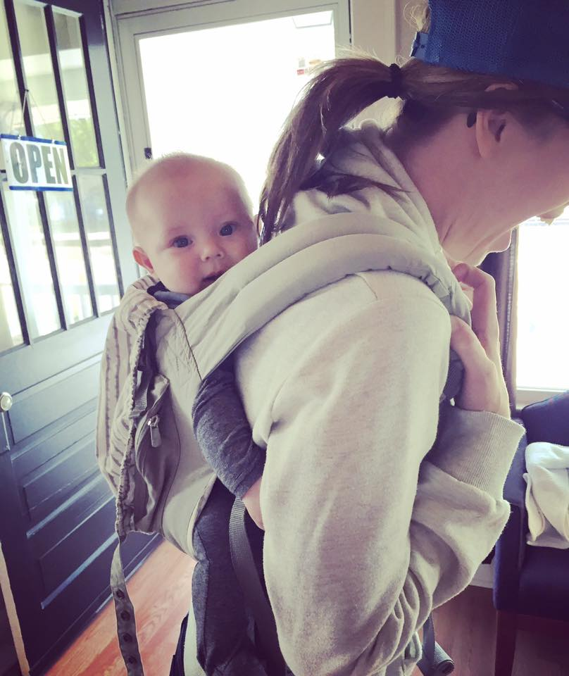 We don't just help with health and healing here at the Village, we love helping with proper baby wearing techniques also!