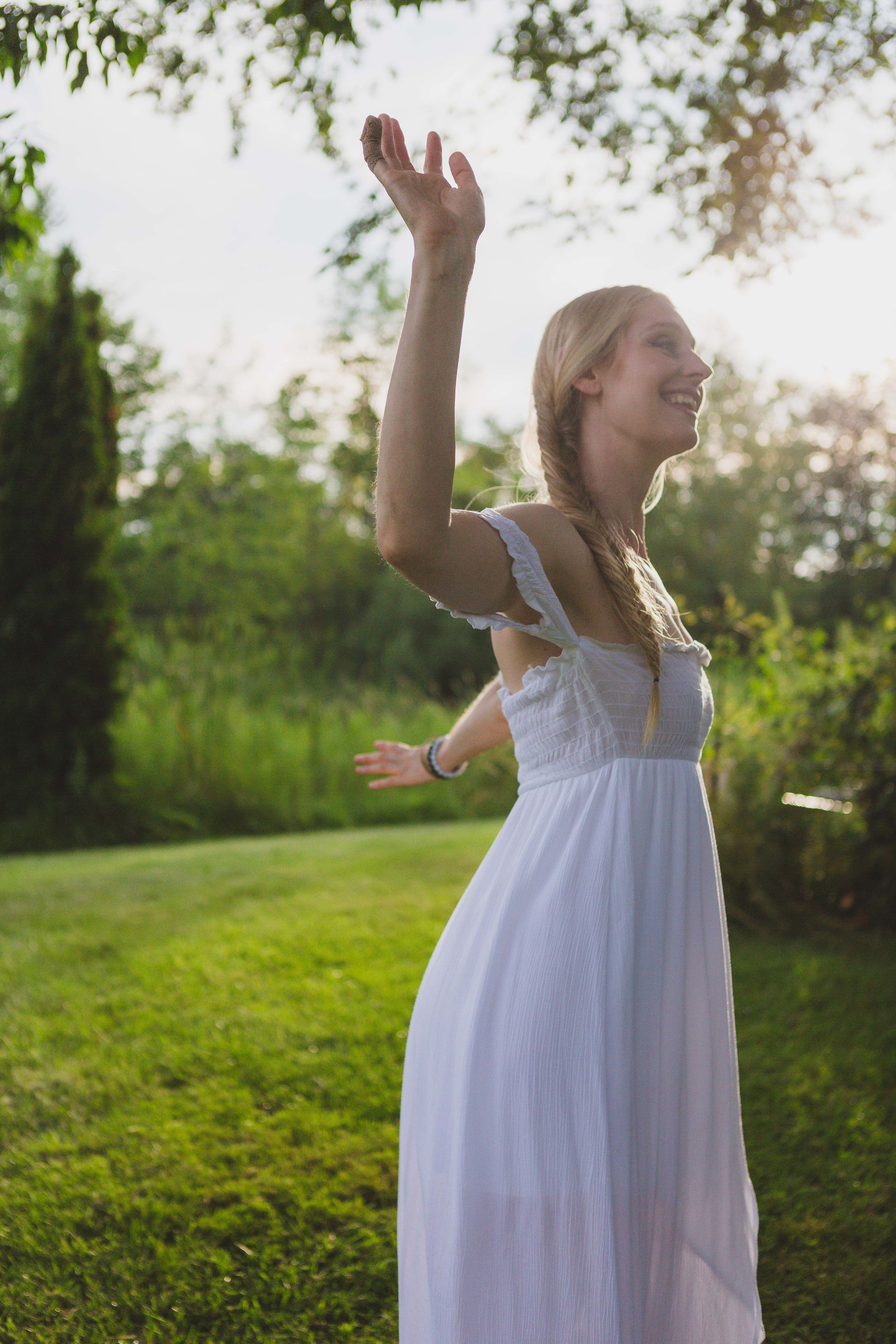 Shelly Burton, energy medicine woman, dancing in the countryside where her healing with horses sessions occur.