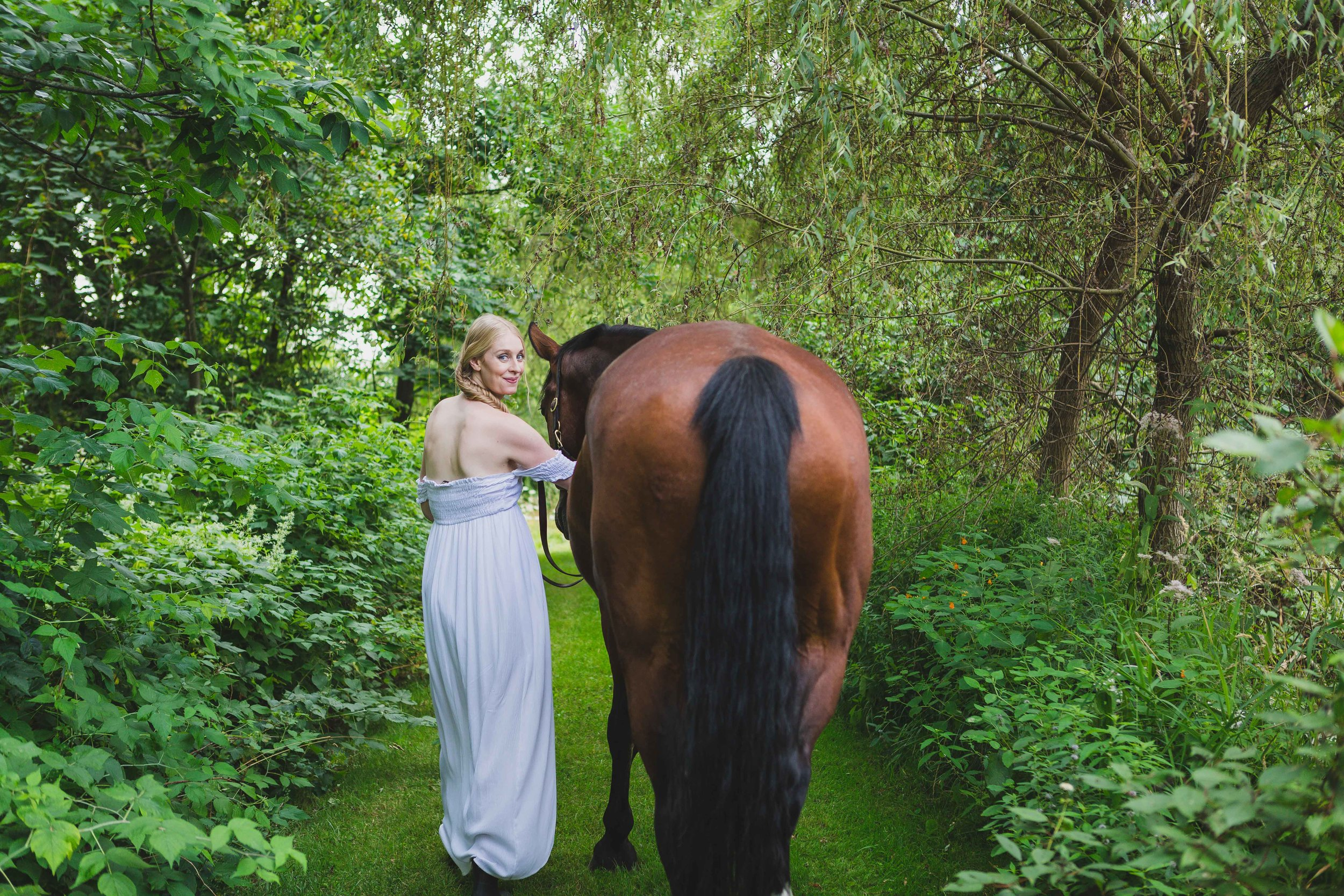 Shelly Burton, energy medicine woman, and her horse Peter journeying into wellness on healing lands.