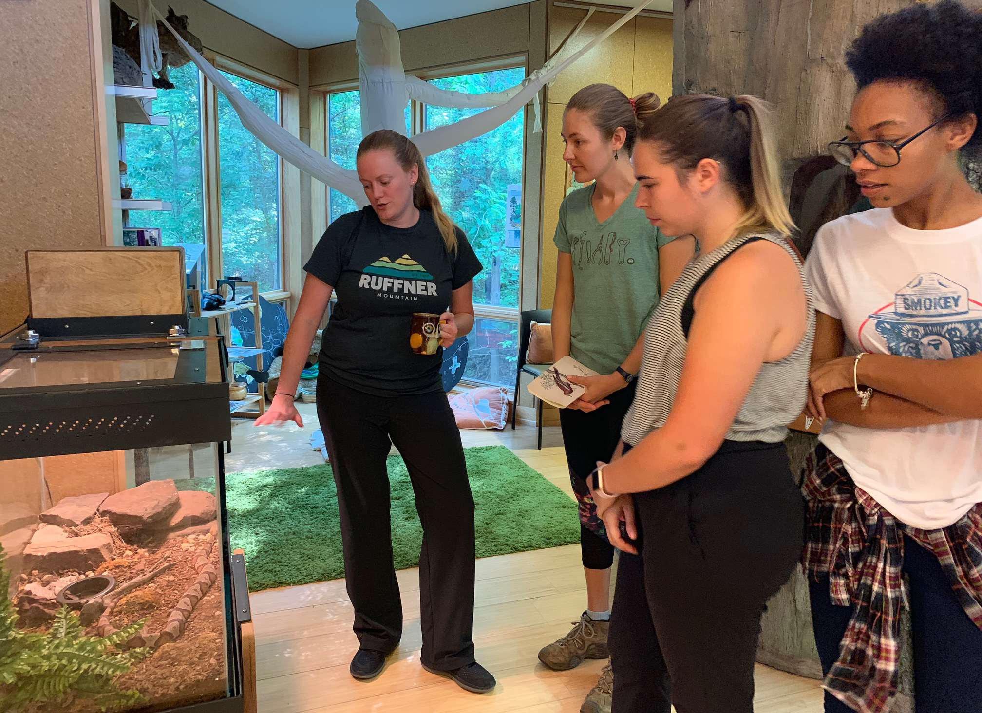 Staff review the native snakes on exhibit, including the copperhead. The public can stop by our Nature Center during office hours to learn the differences between our venomous and non-venomous snakes on exhibit by observing their patterns. Say 'hello' to the corn snake, who is often mistaken for the copperhead.