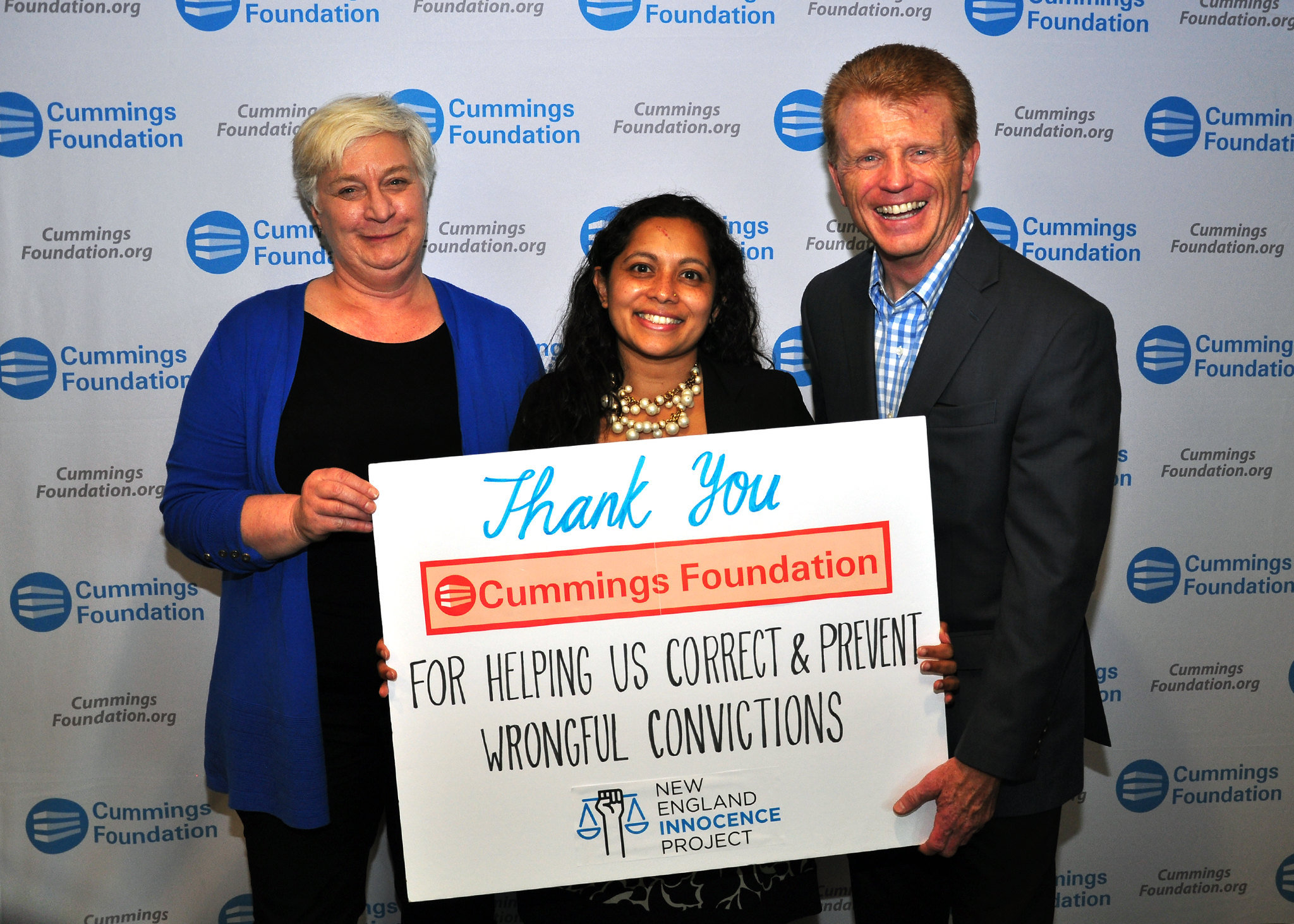 New England Innocence Project Executive Director, Radha Natarajan (middle) and Treasurer, Cheryl Schaffer (left) pose at the photo booth with Cummings Foundation Trustee, Paul Casey at the reception for grant recipients in Woburn.