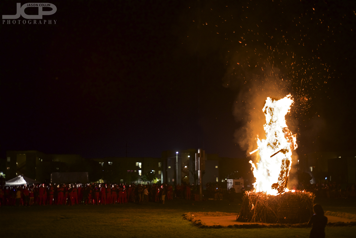 Burning the Aggie at the UNM Red Rally 2017 - Nikon D750 with Nikkor 50mm @ f/2 1/60th ISO 1000