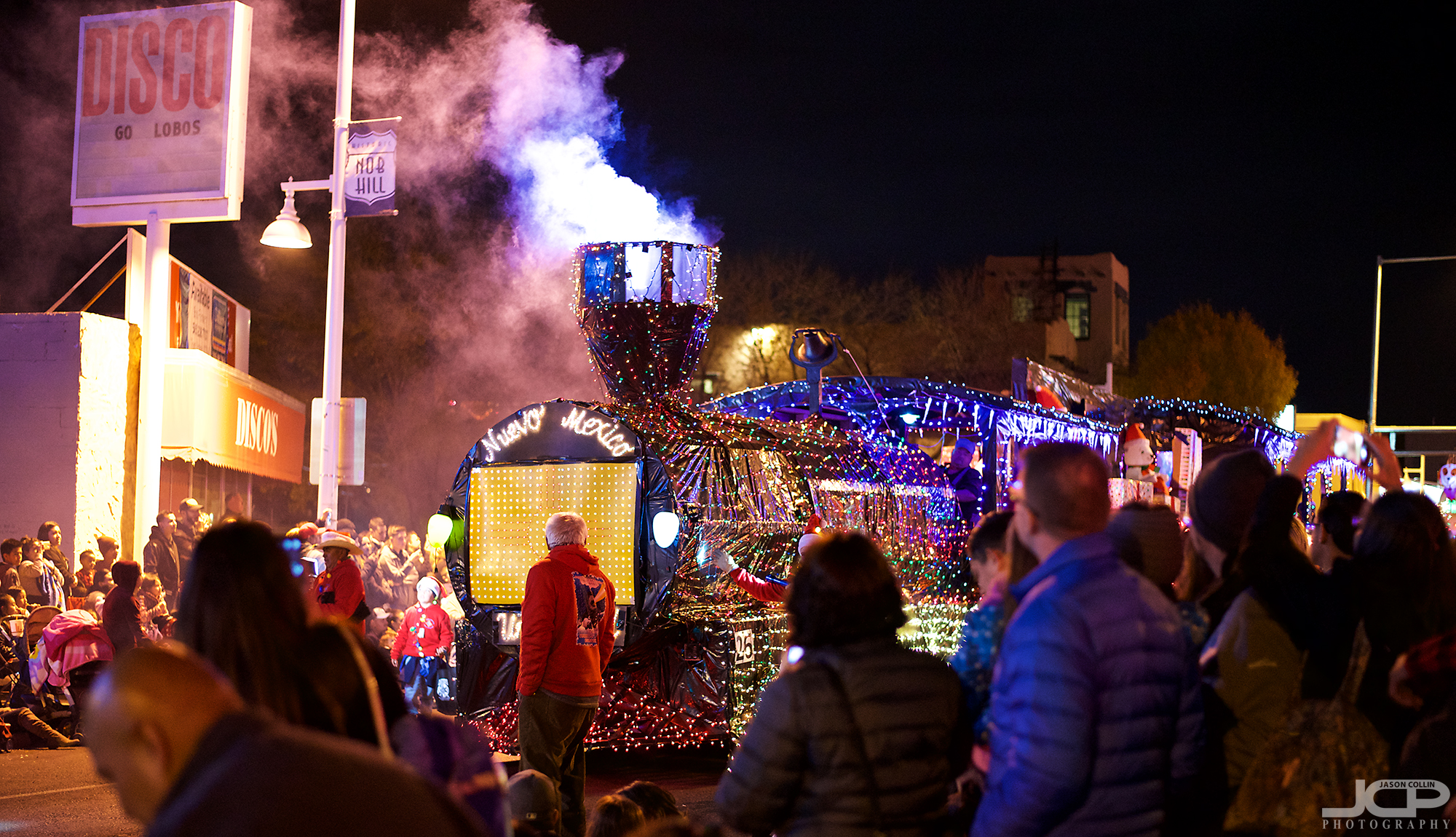 Watch out for the Twinkle Light Parade train!  - Nikon D750 with Nikkor 50mm f/1.8G @ f/1.8 1/60th ISO 4000
