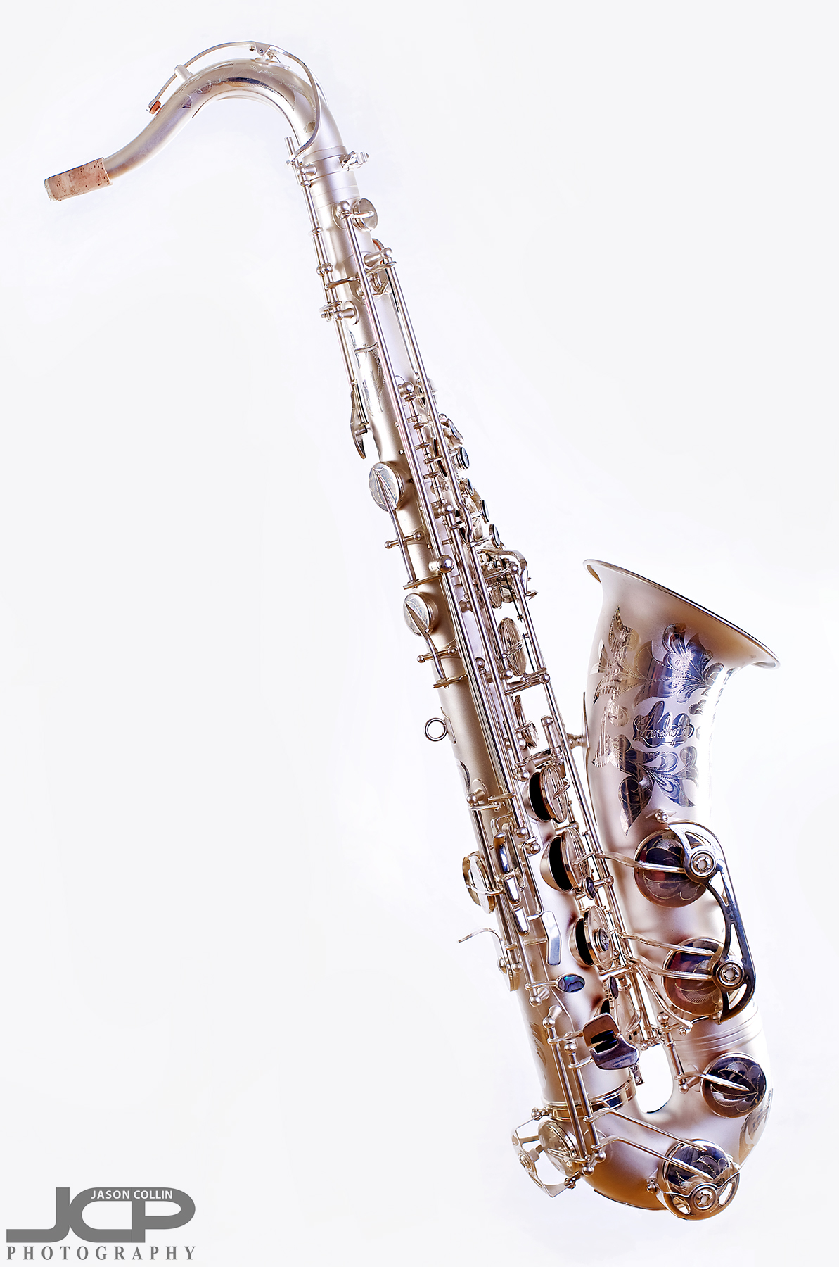 "Profile view of this saxophone with stand digitally removed - Nikon D750 with Nikkor 50mm f/1.8G lens @ f/8 1/160th ISO 100 - Strobist: Westcott Strobe Light Plus in 55"" octagon gridded soft box main with two 43"" shoot through umbrellas with speedlights on the white muslin background"