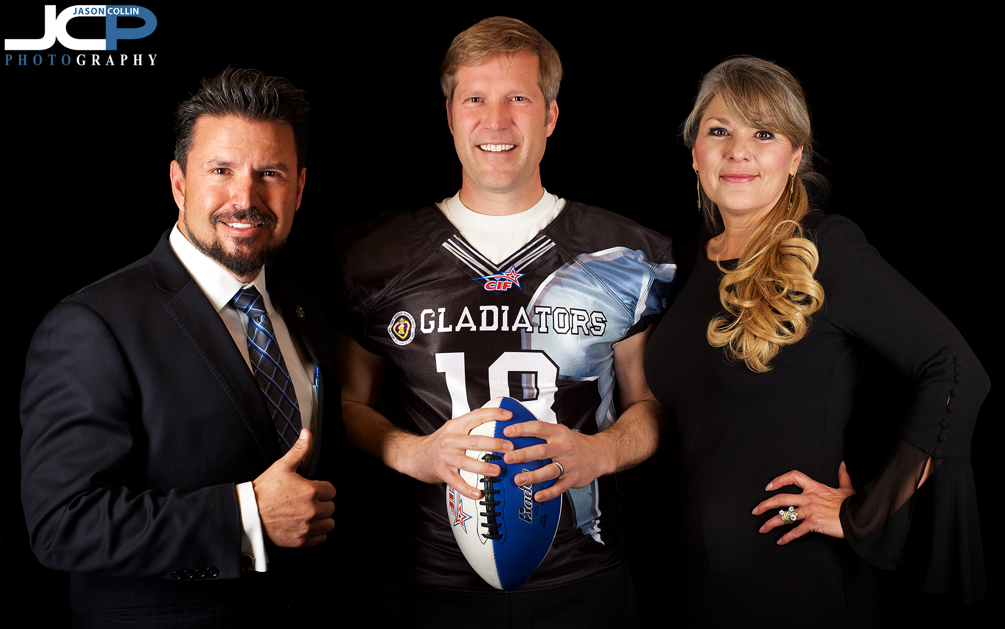 Majority owner John Lopez of the Duke City Gladiators with Mayor Tim Keller in Albuquerque, New Mexico -Nikon D750 with Nikkor 50mm f/1.8G @ f/5.6 1/250th ISO 200 - Strobist: two Cheetahstand 12x55 gridded strip boxes with Nikon SB-800 speedlights to left and right