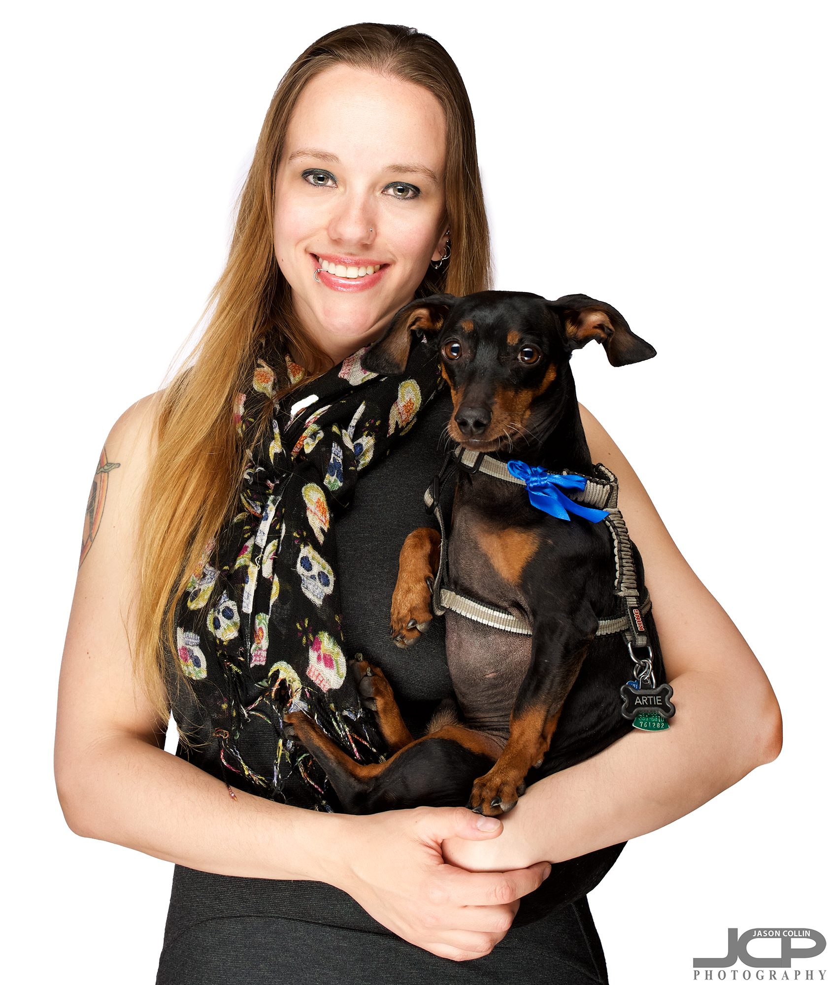 Clamshell lighting can be used for 3/4 portraits as well, even when holding a small dog like Artie who turned 8 years old this very day!