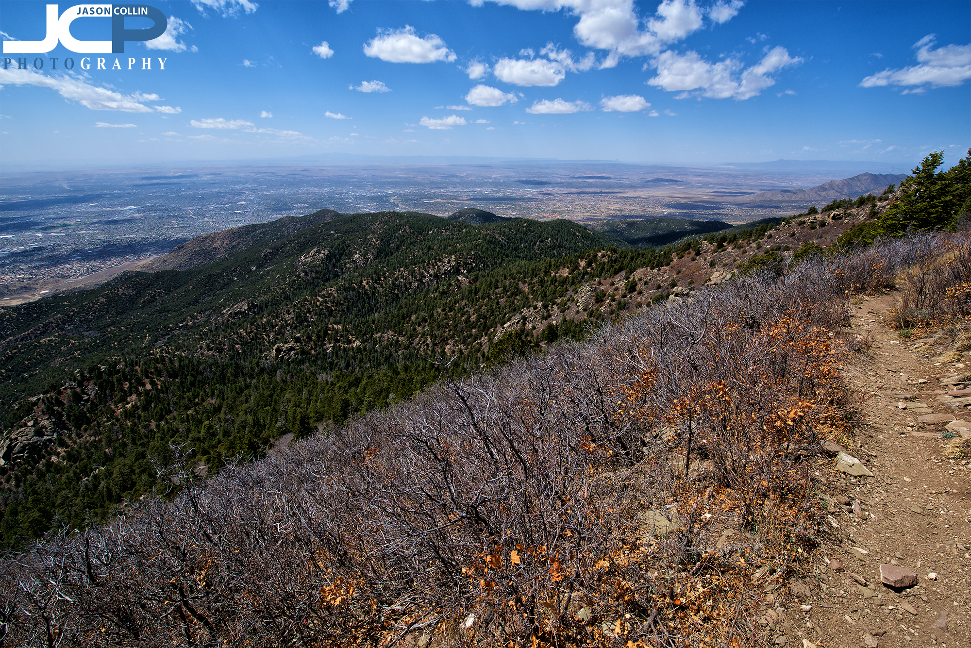The narrow trail on the final stretch to the South Sandia Peak summit with Albuquerque, New Mexico far below.