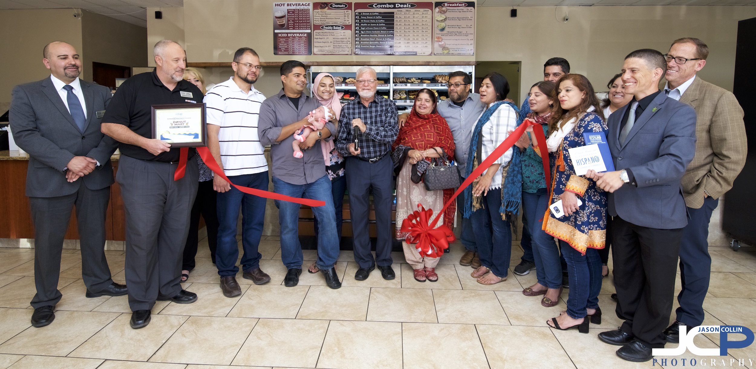 The whole family came for the ribbon cutting at Donut Mart on San Mateo Blvd in Albuquerque, New Mexico
