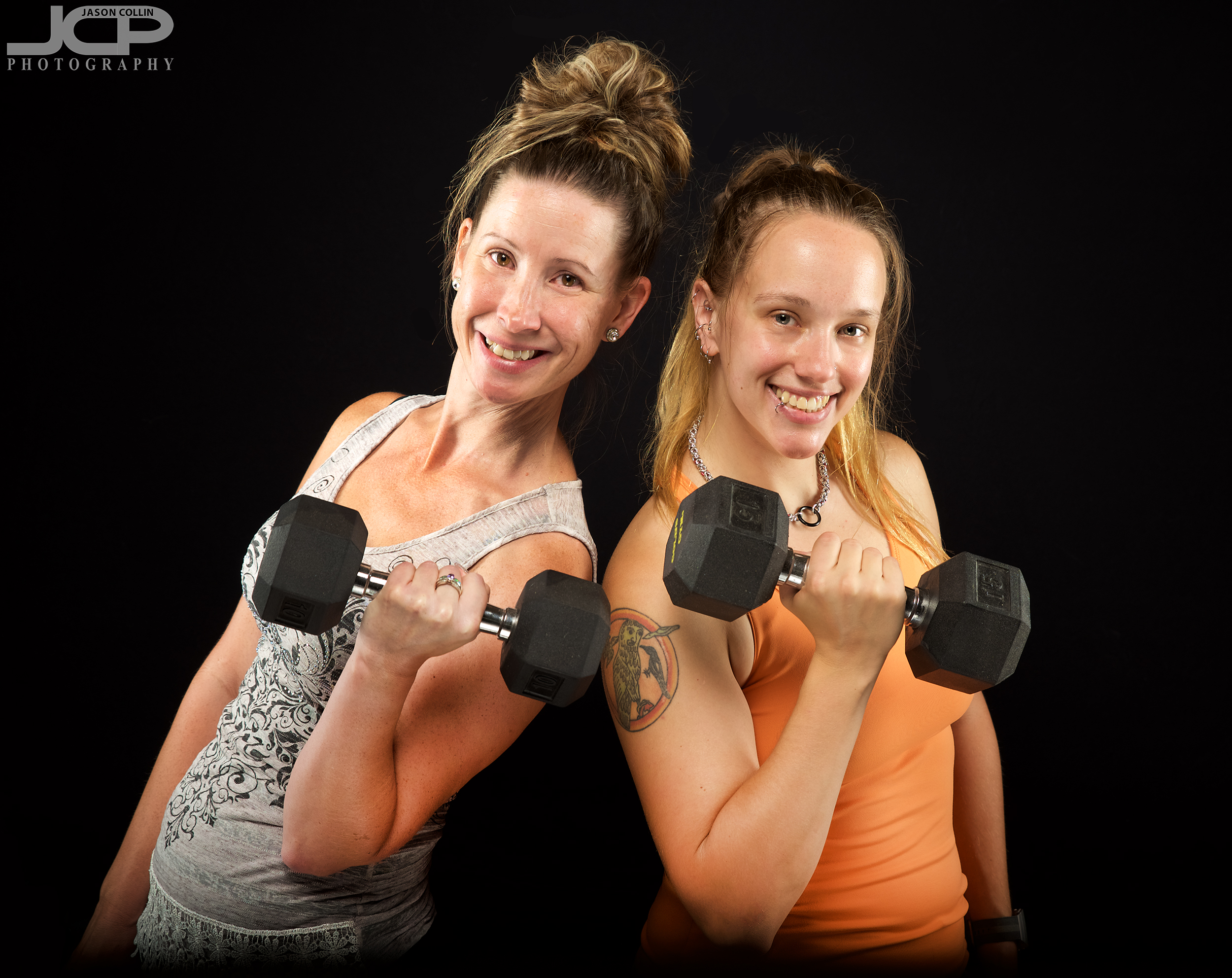 Jess and Jen flexing at the JCP Home Studio in Albuquerque, New Mexico -- Nikon D750 with Tamron 24-70mm f/2.8 G2 lens with a 3-light setup